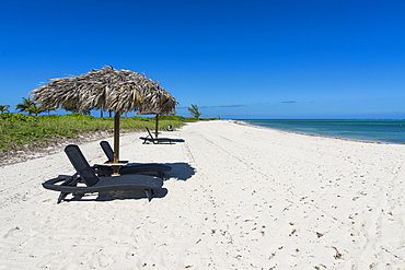 Sun lounger on a white sand beach in northern Providenciales, Turks and Caicos, Caribbean, Central America
