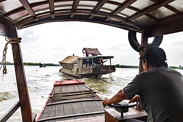 Ferry boat at a water channel, Cai Be, Mekong Delta, Vietnam, Indochina, Southeast Asia, Asia