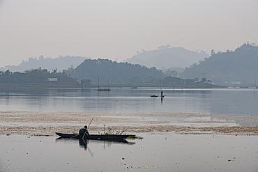 Fisherman in his canoe fishing, Loktak Lake, Moirang, Manipur, India, Asia