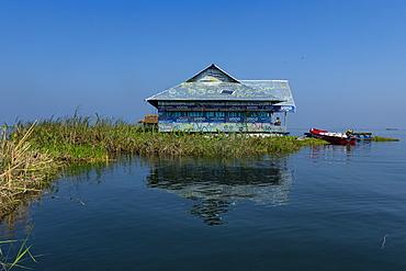 Fisher house on a phumdi (floating island), Loktak Lake, Moirang, Manipur, India, Asia