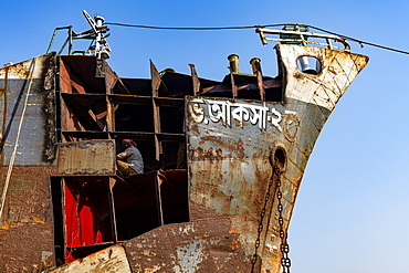 Man welding on a ship, shipwreck cemetery (ship breaking yard), Port of Dhaka, Bangladesh, Asia