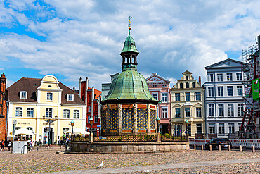 Water fountain on the market square of the Unesco world heritage site Hanseatic city of Wismar, Germany