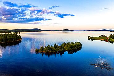 Clouds reflecting at sunset on Lake Inari, Inari, Lapland, northern Finland, Europe