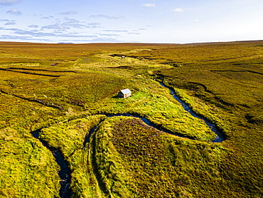 Aerial of a little hut in the Moorland on the Isle of Lewis, Outer Hebrides, Scotland, United Kingdom, Europe