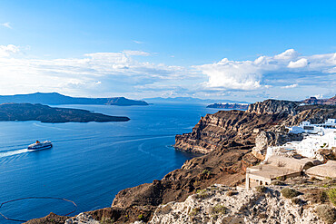 Ferry bypassing the calderea of Fira, Santorini, Greece