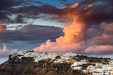 Whitewashed houses on the caldera at sunset, Fira, Santorini, Greece