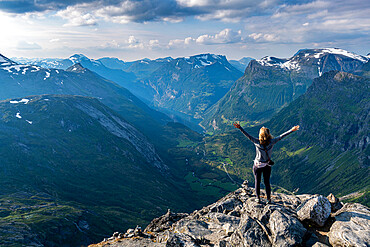 Woman standing on Dalsnibba View point, Geirangerfjord, Sunmore, Norway