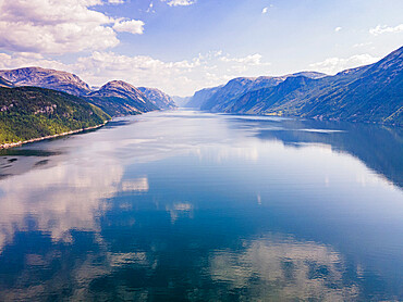 Reflecting mountains in the water, Lystrefjord, Norway