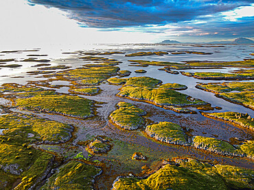 Aerial of the rugged coastline of the Unesco world heritage site at sunset, the Vega Archipelago, Norway