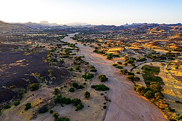 Aerial of a dry valley in the UNESCO World Heritage Site, at sunrise, Air Mountains, Niger, Africa