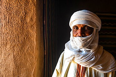 Guardian standing in the Interior of the French Fort in the Oasis of Timia, Air Mountains, Niger, Africa