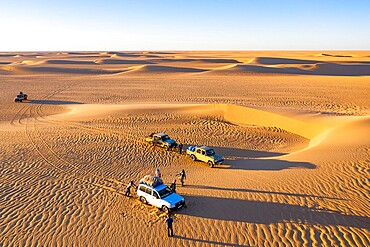Aerials of cars driving through the sand dunes of the Tenere Desert, Sahara, Niger, Africa
