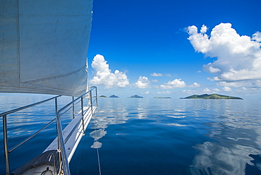 Sailing in the very flat waters of the Mamanuca Islands, Fiji, South Pacific