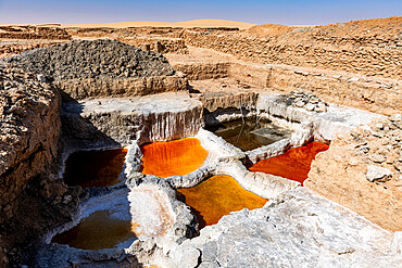 Multi coloured salt pools in the Salt mines of Bilma, Tenere desert, Niger, West Africa, Africa