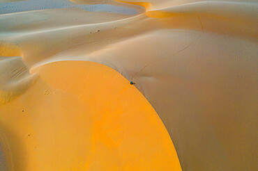 Aerials of sand dunes at sunset, Dirkou, Djado Plateau, Niger, West Africa, Africa