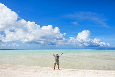 Man standing on a white sand beach in the lagoon of Wallis, Wallis and Futuna, Pacific - 1184-570