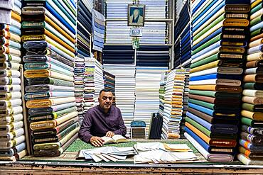 Man in his cloth shop in the Imam Ali Holy Shrine, Najaf, Iraq, Middle East