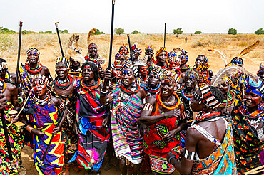 Traditional dressed women of the Jiye tribe dancing and singing, Eastern Equatoria State, South Sudan