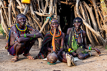 Old woman of the Jiye tribe smoking a pipe, Eastern Equatoria State, South Sudan, Africa