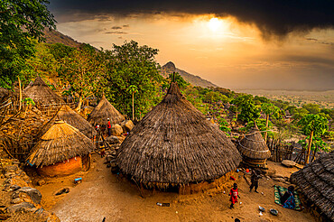 Sunset over traditional huts of the Otuho (Lotuko) tribe, Imatong mountains, Eastern Equatoria, South Sudan, Africa