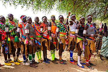 Traditional dressed young girls practising local dances, Laarim tribe, Boya hills, Eastern Equatoria, South Sudan