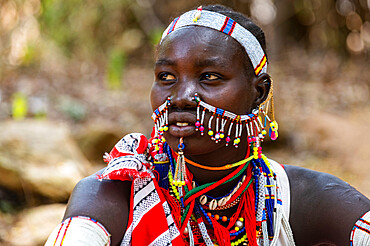 Traditional dressed young girl from the Laarim tribe, Boya Hills, Eastern Equatoria, South Sudan, Africa
