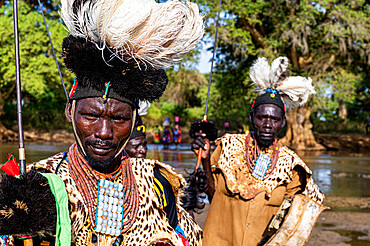 Men from the Toposa tribe posing in their traditional warrior costumes, Eastern Equatoria, South Sudan, Africa
