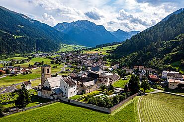 Aerial of the Benedictine Convent of St. John in Mustair on the Swiss alps, Unesco world heritage, Switzerland