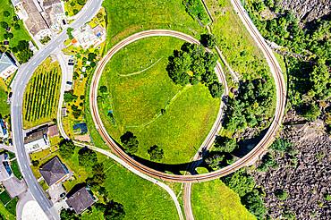 Aerial of the Brusio spiral viaduct, UNESCO World Heritage Site, Rhaetian Railway, Switzerland, Europe