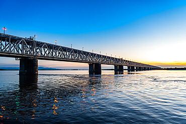 Giant bridge spanning over the Amur river at sunset, Khabarovsk, Khabarovsk Krai, Russia
