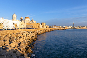 Santa Cruz Cathedral and ocean seen from the promenade along quayside, Cadiz, Andalusia, Spain, Europe