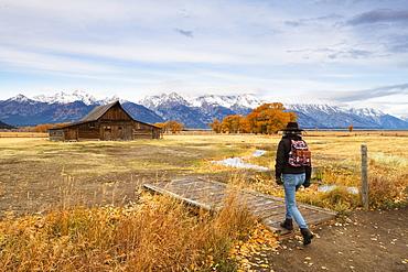 Woman at Mormon Row and Teton Range, Grand Teton National Park, Wyoming, United States of America, North America