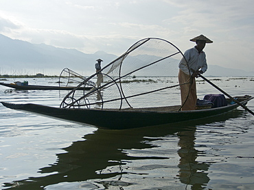 Fishermen cast their nets in Inle Lake, Shan State, Myanmar (Burma), Asia
