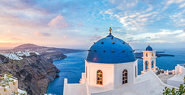 Sunrise shot of the Church in Imerovigli, looking over to Fira and the Caldera of Santorini, Santorini, Cyclades, Aegean Islands, Greek Islands, Greece, Europe