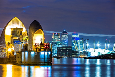 Thames Barrier, Millennium Dome (O2 Arena) and Canary Wharf at night, London, England, United Kingdom, Europe