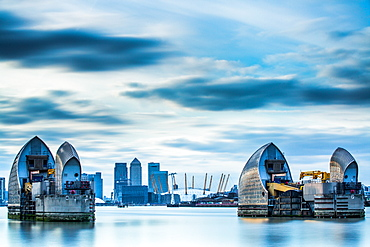 Thames Barrier on River Thames and Canary Wharf in the background, London, England, United Kingdom, Europe