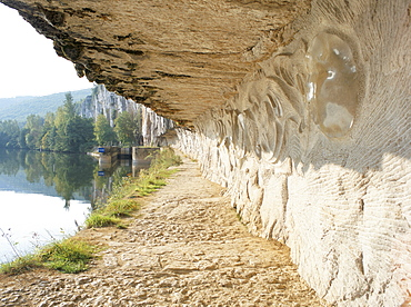 Modern carvings by D. Monnier on wall of tow path beside River Lot, near St. Cirq-Lapopie, east of Cahors, Midi-Pyrenees, France, Europe