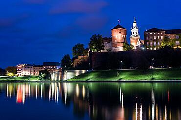 Wawel Castle, UNESCO World Heritage Site, across Vistula River, at night, Krakow, Poland, Europe