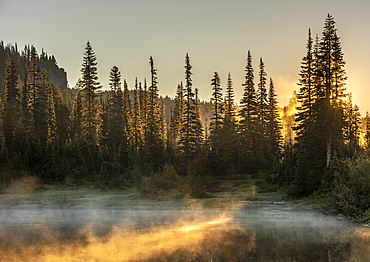 Morning sunlight and mist, Reflection Lake, Mount Rainier National Park, Washington State, United States of America, North America