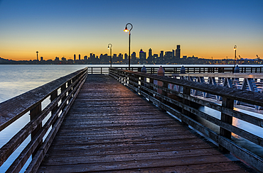 Wooden pier and skyline at dawn, Alki Beach, Seattle, Washington State, United States of America, North America