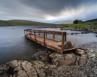 Wooden pier and boathouse on Lake Letisvatn, Vagar Island, Faroe Islands, Denmark, Atlantic, Europe