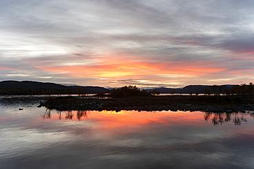 Lake reflection on Lake Kilpis at dusk, Kilpisjarvi, Lapland, Finland, Europe