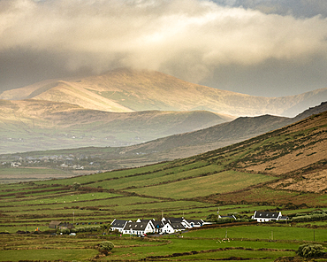 Traditional houses, fields and mountains, looking north from Waymont, Dingle Peninsula, County Kerry, Munster, Republic of Ireland, Europe