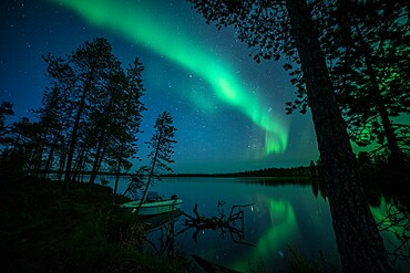 Aurora borealis (Northern Lights) reflected in Lake Pallas, Muonio, Lapland, Finland, Europe