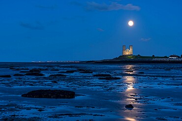 Full moon rising over Reculver Towers, beach at low tide, Reculver, Herne Bay, Kent, England, United Kingdom, Europe