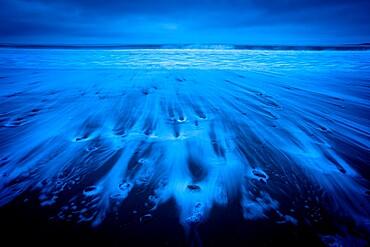 Receding tide at dawn, Oxwich Bay, Gower Peninsula, Swansea, Wales, United Kingdom, Europe