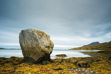 Large rock at low tide, west Senja, Norway, Scandinavia, Europe