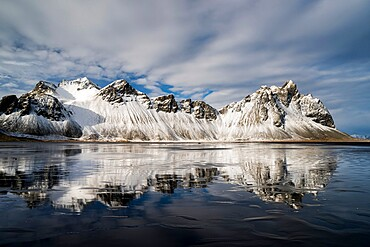 Vestrahorn Mountain reflected in wet sand, Iceland, Polar Regions
