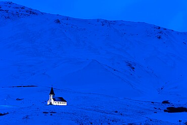 Vik Church illuminated at dawn, Vik, Iceland, Polar Regions