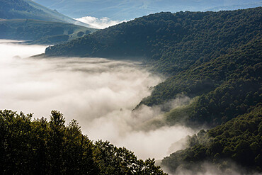 Morning clouds and mist lingering over the Monte Sibillini Mountains, Umbria, Italy, Europe